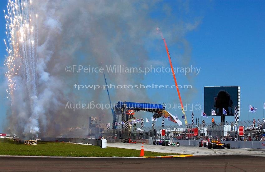 Honda Grand Prix of St. Petersburg, 3 April, 2005.Fireworks signal the start of the pace lap as polesitter Bryan Herta leads the field into turn one. .Copyright©F.Peirce Williams 2005.  ref.Digital Image Only