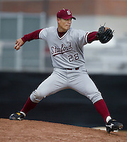 Jeremy Guthrie of the Stanford Cardinal pitches during a 2002 season NCAA game against the Southern California Trojans at Dedeaux Field in Los Angeles, California. (Larry Goren/Four Seam Images)