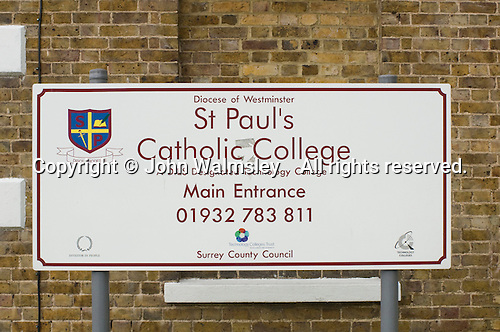 School name sign at the main entrance, State Secondary Roman Catholic school.