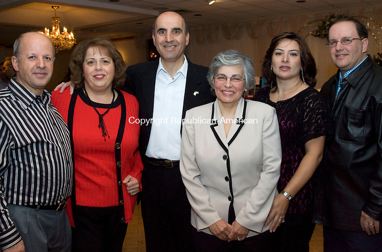 WOLCOTT, CT - 05 NOVEMBER 2009 -110509JT22-<br /> From left, brothers Joseph Noujaim, Rep. Selim Noujaim (R-74th), and Nazih Noujaim with their wives, respectively, Daad, Linda and Celine during Thursday's wine tasting hosted by Saint Mary School, with help from Mountain Top Liquors in Wolcott, at Mahan's Lakeview in Wolcott. <br /> Josalee Thrift Republican-American