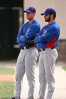 Chris Carpenter #60 (left) and Trey McNutt #71 (right) of the Chicago Cubs wait their turns for a bullpen session during spring training workouts at the Cubs complex on February 19, 2011  in Mesa, Arizona. .Photo by Bill Mitchell / Four Seam Images.