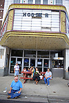 People sit outside an abandoned movie theater during the annual gathering of Slavic cuisine lovers at Pierogi Fest on 119th Street in Whiting, Indiana on July 26, 2009.