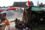 A protesters slept under a plastic tent on Tahrir Square, Cairo, Egypt, Feb. 6, 2011. Protesters spent a 13th day demonstrating against President Hosni Mubarak, who remains in power.