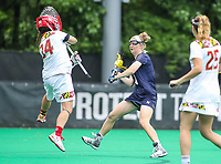 College Park, MD - May 19, 2018: Navy Meg O'Donnell (4) scores a goal during the quarterfinal game between Navy and Maryland at  Field Hockey and Lacrosse Complex in College Park, MD.  (Photo by Elliott Brown/Media Images International)