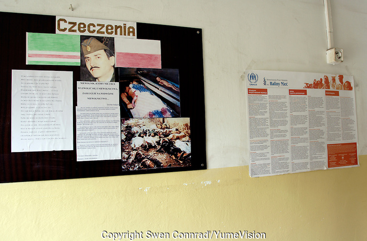 Billboard with Former Chechen President Dzhokhar Dudayev, kill by Russian force in 21 April 1996 and pictures of massacred civilians in Chechnya..Next to the right, a UNHCR international refugee law information with address of the UN and NGO office.