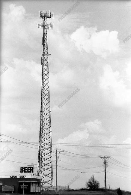 Route 66: Radio tower and food store.