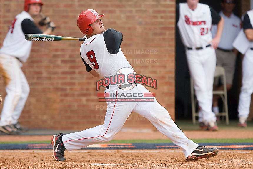 Joe Witkowski #9 of the St. John's Red Storm follows through on his swing against the Ole Miss Rebels at the Charlottesville Regional of the 2010 College World Series at Davenport Field on June 6, 2010, in Charlottesville, Virginia.  The Red Storm defeated the Rebels 20-16.  Photo by Brian Westerholt / Four Seam Images