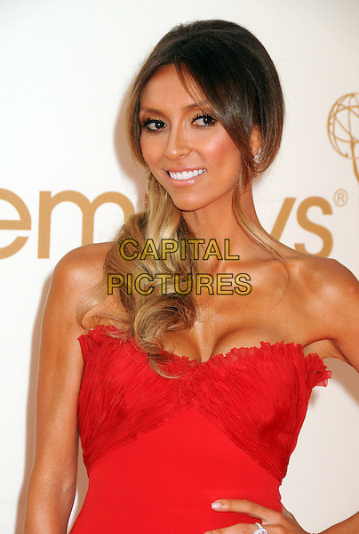 Giuliana Rancic.63rd Primetime Emmy Awards held at Nokia Theatre L.A. Live. Los Angeles, California, USA. .18th September 2011.emmys half length red strapless dress .CAP/ADM/BP.©Byron Purvis/AdMedia/Capital Pictures.