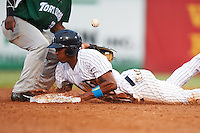 Tampa Yankees Rashad Crawford (22) slides into second as Shed Long (13) can't come up with the throw during a game against the Daytona Tortugas on August 5, 2016 at George M. Steinbrenner Field in Tampa, Florida.  Tampa defeated Daytona 7-1.  (Mike Janes/Four Seam Images)