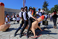 Pictured: Two men and a woman ride a penis shaped see-saw during the celebrations in Tirnavos, central Greece. Monday 11 March 2019<br /> Re: Bourani (or Burani) the infamous annual carnival which dates to 1898 which takes place on the day of (Clean Monday), the first days of Lent in Tirnavos, central Greece, in which men hold phallus shaped objects as scepters in their hands.