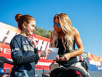 Feb 25, 2018; Chandler, AZ, USA; NHRA top fuel driver Leah Pritchett (right) with a young fan during the Arizona Nationals at Wild Horse Pass Motorsports Park. Mandatory Credit: Mark J. Rebilas-USA TODAY Sports