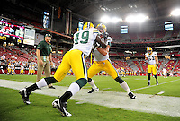 Aug. 28, 2009; Glendale, AZ, USA; Green Bay Packers linebacker (74) Aaron Kampman warms up with linebacker (49) Cyril Obiozor prior to the game against the Arizona Cardinals during a preseason game at University of Phoenix Stadium. Mandatory Credit: Mark J. Rebilas-