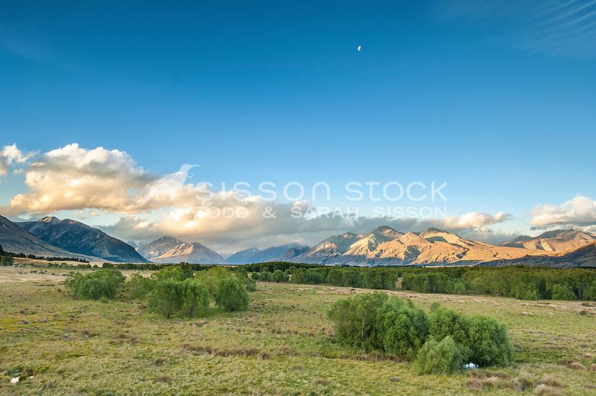 Moon & sunset mountains. Lower Rangitata river valley, Canterbury NZ.