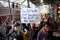 "Protesters march to the Brooklyn Bridge as ""Occupy Wall Street"" hits its two week anniversary in New York City on October 1, 2011."