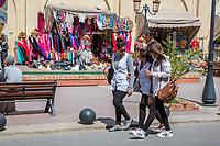 Marrakesh, Morocco.  Three Young Moroccan Women Walking near the Saadian Tombs.