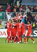 15 April 2010: Toronto FC players celebrate a goal by Toronto FC midfielder Dwayne De Rosario #14 during a game between the Philadelphia Union and Toronto FC at BMO Field in Toronto..Toronto FC won 2-1..Photo by Nick Turchiaro/isiphotos.com.