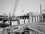 Pittsburgh PA: View of workers from the Cemensteel Company preparing to install prefabricated sections for the new Homewood Elementary School.<br /> The unique product consisted of prefabricated steel and concrete that was delivered to a job site for  a more streamlined construction of a building.<br /> Not sure how well it worked, the company was incorporated in 1958 but was out of business in 1963.