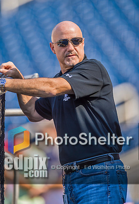 22 August 2015: Washington Nationals General Manager Mike Rizzo watches practice from behind the batting cage prior to a game against the Milwaukee Brewers at Nationals Park in Washington, DC. The Nationals defeated the Brewers 6-1 in the second game of their 3-game weekend series. Mandatory Credit: Ed Wolfstein Photo *** RAW (NEF) Image File Available ***