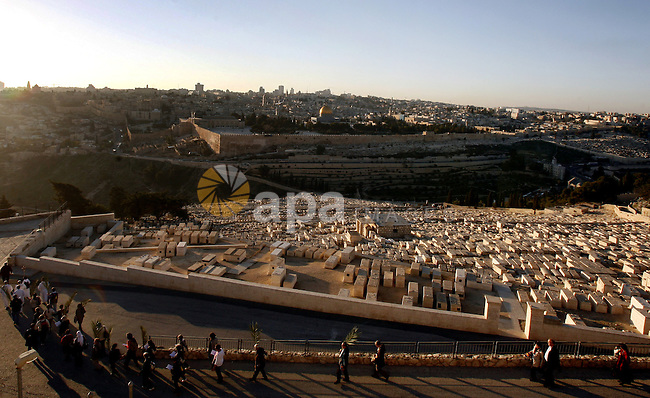 Foreign tourists walk visit the Jerusalem's old city on December 31, 2012. Photo by Mahfouz Abu Turk