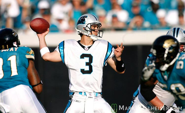 Carolina quarterback Matt Moore passes during 37-6 loss to ... 925e82d42