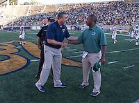 Saturday, September 7, 2013: Sonny Dykes shakes with Portland State's Nigel Burton during post game shake at Memorial Stadium, Berkeley, California - California defeated Portland State 37 - 30