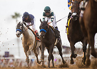 DEL MAR, CA - NOVEMBER 03: Cupid #7, ridden by Rafael Bejarano, battles against Mor Spirit (PA)#6, ridden by Mike Smith, along with the rest of the pack during the Breeders' Cup Las Vegas Dirt Mile on Day 1 of the 2017 Breeders' Cup World Championships at Del Mar Thoroughbred Club on November 3, 2017 in Del Mar, California. (Photo by Alex Evers/Eclipse Sportswire/Breeders Cup)