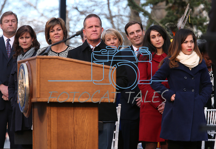 Officials on the dais listen as the McQueen High School choir performs at the inaugural ceremony at the Capitol, in Carson City, Nev., on Monday, Jan. 5, 2015.<br /> Photo by Cathleen Allison