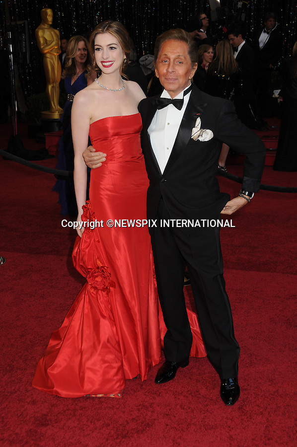 "ANNE HATHAWAY AND VALENTINO - Oscars 2011.83rd Academy Awards arrivals, Kodak Theatre, Hollywood, Los Angeles_27/02/2011.Mandatory Photo Credit: ©Phillips-Newspix International..**ALL FEES PAYABLE TO: ""NEWSPIX INTERNATIONAL""**..PHOTO CREDIT MANDATORY!!: NEWSPIX INTERNATIONAL(Failure to credit will incur a surcharge of 100% of reproduction fees)..IMMEDIATE CONFIRMATION OF USAGE REQUIRED:.Newspix International, 31 Chinnery Hill, Bishop's Stortford, ENGLAND CM23 3PS.Tel:+441279 324672  ; Fax: +441279656877.Mobile:  0777568 1153.e-mail: info@newspixinternational.co.uk"