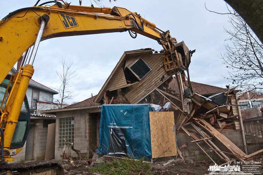 The Japanese Tea House in Uptown Westerville is reduced to rubble Wednesday as the last building on the property is demolished.  The abandoned buildings and shrine were demolished after the buildings fell into disrepair when it's original owners died and new owner failed to maintain its condition. The property was purchased by the city  which has yet to decide how to use the soon to be cleared land..