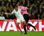 Raheem Sterling of England tussles with Lee Wallace of Scotland during the FIFA World Cup Qualifying Group F match at Wembley Stadium, London. Picture date: November 11th, 2016. Pic David Klein/Sportimage