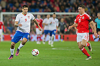 Aleksandar Mitrovic of Serbia takes on James Chester of Wales during the FIFA World Cup Qualifying match between Wales and Serbia at the Cardiff City Stadium, Cardiff, Wales on 12 November 2016. Photo by Mark  Hawkins.