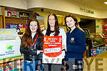 L-R Sarah&Sinead Buckley of Buckleys Great Gas, East End Ballybunion with staff member Teegan Meehan showing the the amount of over 289 thousand euro won by a local man on the Lotto baught in their shop.