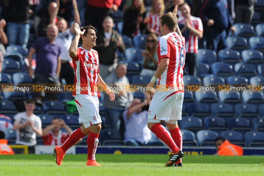 New signing Bojan Krkic (left) of Stoke City celebrates the equaliser - Blackburn Rovers vs Stoke City - Pre-Season Friendly Football Match at Ewood Park, Blackburn, Lancashire - 03/08/14 - MANDATORY CREDIT: Greig Bertram/TGSPHOTO - Self billing applies where appropriate - contact@tgsphoto.co.uk - NO UNPAID USE
