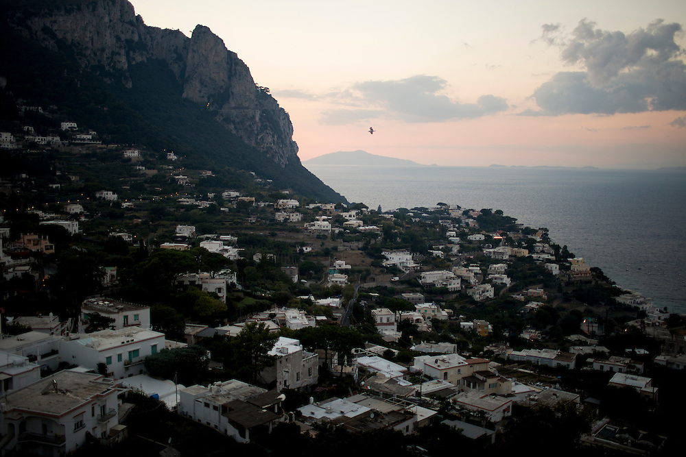 Homes are seen at sunset on Monday, Sept. 21, 2015, on the island of Capri in Italy. (Photo by James Brosher)