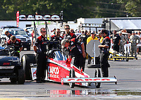 Aug 15, 2014; Brainerd, MN, USA; Crew members wait with NHRA top fuel dragster driver Steve Torrence at the water box during qualifying for the Lucas Oil Nationals at Brainerd International Raceway. Mandatory Credit: Mark J. Rebilas-