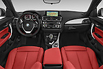 Stock photo of straight dashboard view of 2017 BMW 2-Series 230i 2 Door Convertible Dashboard