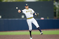 Michigan Wolverines third baseman Jake Bivens (18) makes a throw to first base against the Oakland Golden Grizzlies on May 17, 2016 at Ray Fisher Stadium in Ann Arbor, Michigan. Oakland defeated Michigan 6-5 in 10 innings. (Andrew Woolley/Four Seam Images)