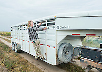 Zachary Sobol (cq) catches a ride on a trailer to the Stanley Brother's Charlotte's Web farm during harvest of industrial grade hemp near Wray, Colorado, Monday, September 22, 2014. The Stanley Brothers have developed a popular strain of marijuana that has been found to be helpful in reducing seizures. The marijuana high in CBDs and low in THC, the chemical which gets a person stoned.<br /> <br /> Photo by Matt Nager