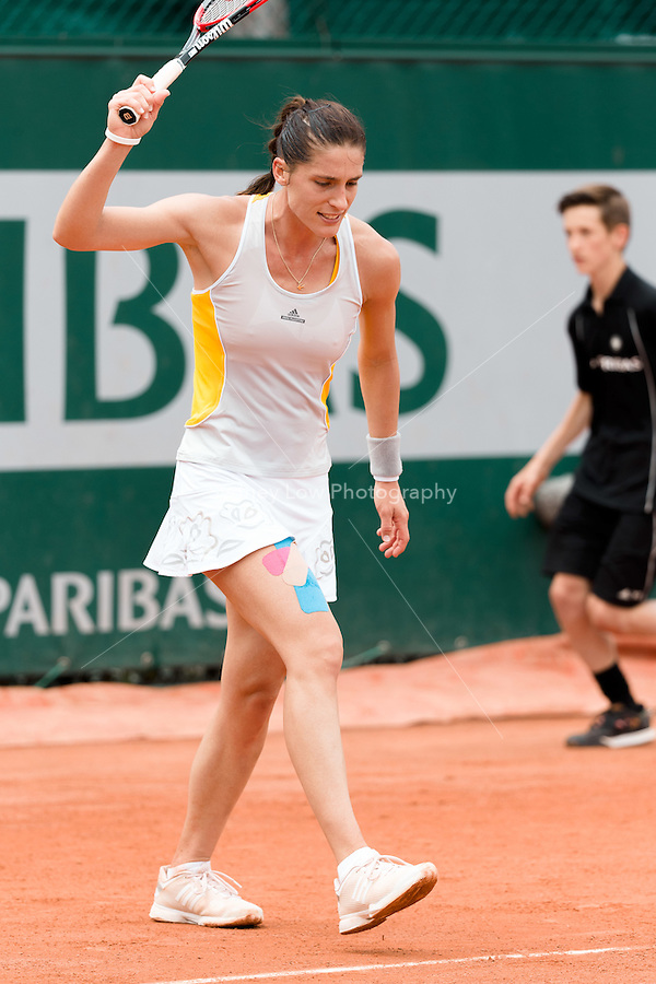 May 28, 2015: Andrea PETKOVIC of Germany reacts after a bad ball bounce in a 2nd round match against Lourdes Dominguez Lino of Spain on day five of the 2015 French Open tennis tournament at Roland Garros in Paris, France. Sydney Low/AsteriskImages