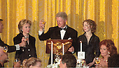 United States President Bill Clinton makes a toast at the White House Millennium dinner in Washington, D.C. on December 31, 1999. (L-R) First Lady Hillary Rodham Clinton, United States President Bill Clinton, Chelsea Clinton.  At far right is actress Sophia Loren.<br /> Credit: Ron Sachs / CNP