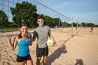 Young fit couple on the at the Zilker Park sand volleyball courts <br />
