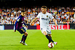 Kevin Gameiro of Valencia CF (R) in action against Philippe Coutinho of FC Barcelona (L) during their La Liga 2018-19 match between Valencia CF and FC Barcelona at Estadio de Mestalla on October 07 2018 in Valencia, Spain. Photo by Maria Jose Segovia Carmona / Power Sport Images