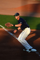 Cedar Rapids Kernels first baseman Chad Christensen (18) waits for a throw during a game against the Quad Cities River Bandits on August 18, 2014 at Perfect Game Field at Veterans Memorial Stadium in Cedar Rapids, Iowa.  Cedar Rapids defeated Quad Cities 4-2.  (Mike Janes/Four Seam Images)