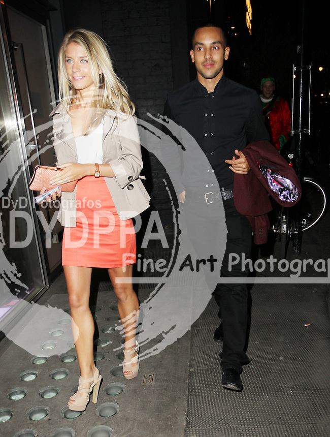 Arsenal FC Xmas Party at L'Atelier Restaurant in West St, London<br /> <br /> Theo Walcott and Melanie Slade<br /> <br /> . Photo: Iso / DYD Fotografos