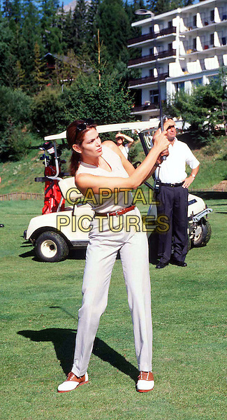 CINDY CRAWFORD .At The Pro-Celeb Golf Open In Crans-Montana, Switzerland.Ref: MAX.golf, sport, playing, tee, full length, full-length.www.capitalpictures.com.sales@capitalpictures.com.© Capital Pictures