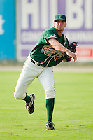 Robert Morey #24 of the Greensboro Grasshoppers warms up in the outfield prior to pitching against the Kannapolis Intimidators at Fieldcrest Cannon Stadium August 2, 2010, in Kannapolis, North Carolina.  Photo by Brian Westerholt / Four Seam Images