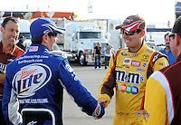 Feb. 27, 2009; Las Vegas, NV, USA; NASCAR Sprint Cup Series driver Kyle Busch (right) is congratulated by brother Kurt Busch during qualifying for the Shelby 427 at Las Vegas Motor Speedway. Mandatory Credit: Mark J. Rebilas-
