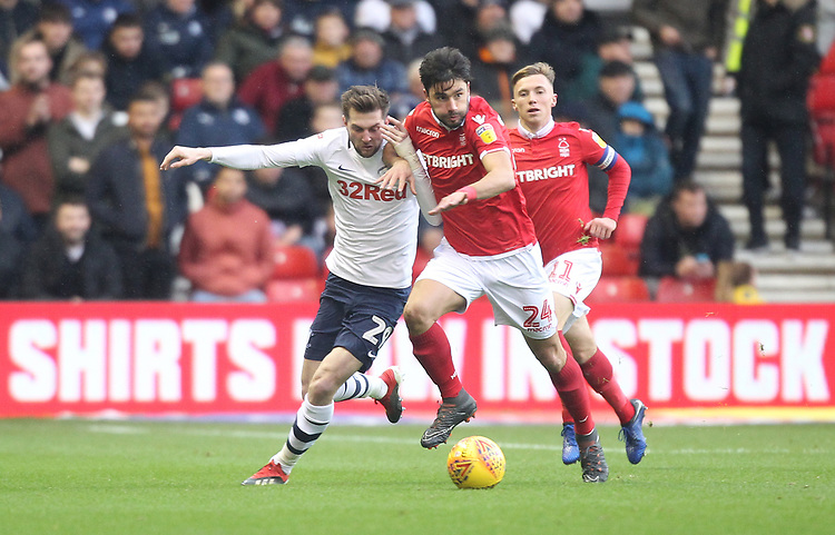 Preston North End's Tom Barkuizen battles with  Nottingham Forest's Claudio Yacob<br /> <br /> Photographer Mick Walker/CameraSport<br /> <br /> The EFL Sky Bet Championship - Nottingham Forest v Preston North End - Saturday 8th December 2018 - The City Ground - Nottingham<br /> <br /> World Copyright © 2018 CameraSport. All rights reserved. 43 Linden Ave. Countesthorpe. Leicester. England. LE8 5PG - Tel: +44 (0) 116 277 4147 - admin@camerasport.com - www.camerasport.com