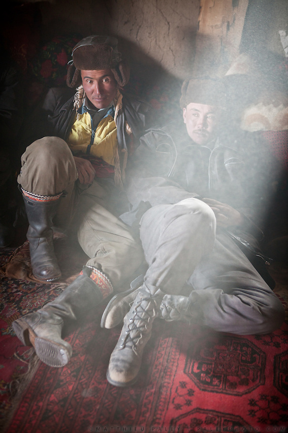 Two Kyrgyz men take a rest..Trekking with yak caravan through the Little Pamir where the Afghan Kyrgyz community live all year, on the borders of China, Tajikistan and Pakistan.