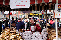 A street vendor sells nuts to fans outside Fenway Park on the day of the 2011 Boston Red Sox season opener in Boston, Massachusetts, USA.